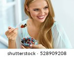 woman on healthy diet eating... | Shutterstock . vector #528909208