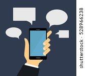 hand holding mobile phone in... | Shutterstock .eps vector #528966238