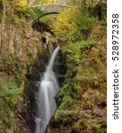 Flowing Waterfall With Old...