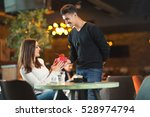 young man gives a gift to a... | Shutterstock . vector #528974794