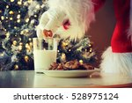 hand of santa claus picking... | Shutterstock . vector #528975124
