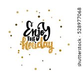enjoy the holiday calligraphy... | Shutterstock .eps vector #528977068