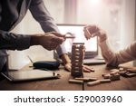 playing jenga  | Shutterstock . vector #529003960