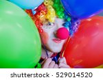 Clown With A Bunch Of Colorful...