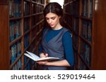 woman reading in a library. | Shutterstock . vector #529019464