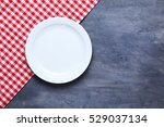 empty plate with napkin on grey ... | Shutterstock . vector #529037134