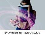 woman with glasses of virtual... | Shutterstock . vector #529046278
