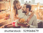 beautiful young couple is... | Shutterstock . vector #529068679