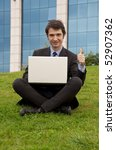successful manager with notebook thumb up - stock photo