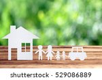 paper family on wooden table... | Shutterstock . vector #529086889