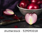 red onion in aluminum pan on a...