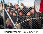 refugees waiting behind barbed... | Shutterstock . vector #529129744