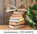 old books and christmas tree on ...   Shutterstock . vector #529129873