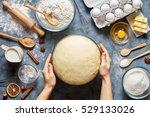 hands working with dough... | Shutterstock . vector #529133026