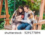 a pregnant young woman and her... | Shutterstock . vector #529177894