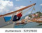 Wooden woman figure on yacht - stock photo