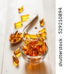 Fish Oil Capsules On Wooden...