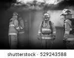 Small photo of Fire Team Outside Smoking Building