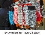 warm mittens on christmas market | Shutterstock . vector #529251004
