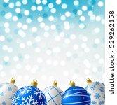 blue christmas balls on shiny... | Shutterstock .eps vector #529262158