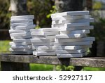 Three stacks of white artists canvas ready to use. - stock photo