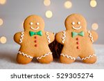 two gingerbread man with candy... | Shutterstock . vector #529305274