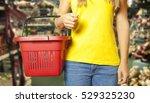 woman holds a shopping basket... | Shutterstock . vector #529325230