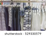 hanging skirts and shirts on... | Shutterstock . vector #529330579