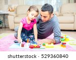 Father And Little Daughter Are Playing With Toys Together At Home - stock photo