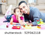 father and little daughter are... | Shutterstock . vector #529362118