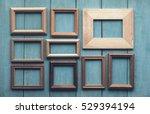 old wooden frames on old blue... | Shutterstock . vector #529394194