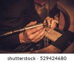 jeweler at work in jewelery... | Shutterstock . vector #529424680