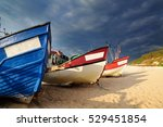 Fishing Boat On The Shore Of...
