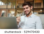 cheerful businessman dressed in ... | Shutterstock . vector #529470430