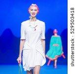Small photo of MADRID - SEPTEMBER 16: a model walks on the Agatha Ruiz de la Prada catwalk during the Mercedes-Benz Fashion Week Madrid Spring/Summer 2017 runway on September 16, 2016 in Madrid.