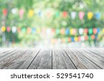 empty wooden table with party... | Shutterstock . vector #529541740