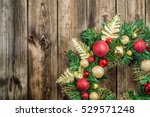 christmas wreath on wooden door ... | Shutterstock . vector #529571248