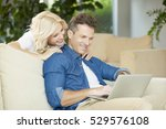 shot of mature couple surfing... | Shutterstock . vector #529576108