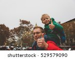 father and little son travel in ... | Shutterstock . vector #529579090