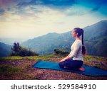 yoga exercise outdoors    woman ... | Shutterstock . vector #529584910