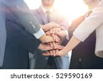business team joining hands... | Shutterstock . vector #529590169