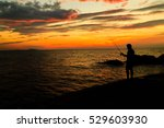 Silhouettes Of Fisherman On Th...