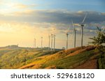 wind turbines on sunny morning | Shutterstock . vector #529618120