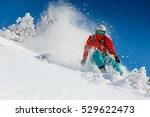 skier skiing downhill in high... | Shutterstock . vector #529622473