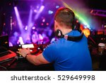 dj stands before the mixer | Shutterstock . vector #529649998