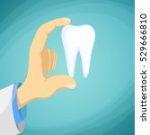 doctor dentist holding a human... | Shutterstock . vector #529666810