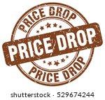 price drop. stamp. brown round... | Shutterstock .eps vector #529674244