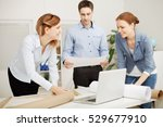 young coworkers working on a... | Shutterstock . vector #529677910