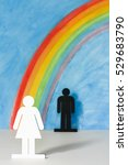 Small photo of Man and women icons with a rainbow and blue sky to illustrate the concept of gender equality and discrimination at work; woman in foreground.