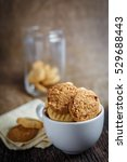 cookies in cup on a wooden table | Shutterstock . vector #529688443